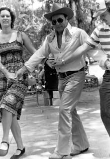 Secretary of State George Firestone (center), Florida Folklife Program director Phillip A. Werndli and Patti Schutt dancing with the Drava Folkdance Ensemble at the 1980 Florida Folk Festival: White Springs, Florida