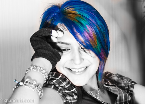 Multicolored Blue hair on a pretty teen with a great smile