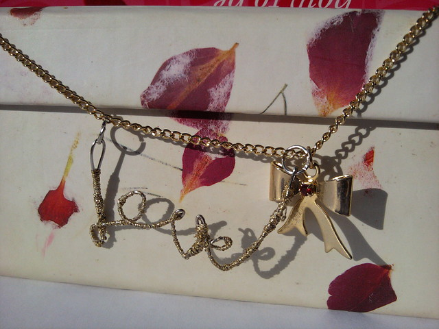 Finished DIY love necklace with bow charm and romantic gift box