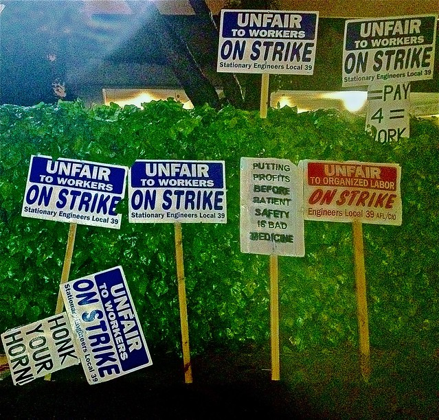 Unfair signs on strike protest