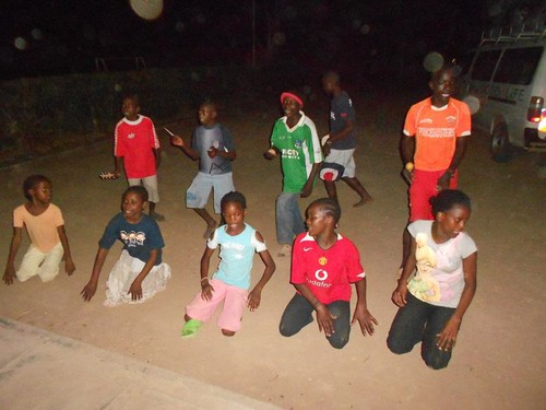 Children singing at night