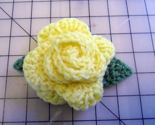 Crocheted yellow rose pin