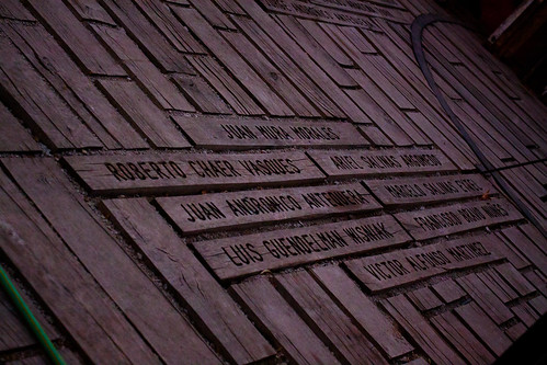 The names of victims, carved into the walkway.