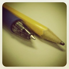 hand(0.0), finger(0.0), writing(0.0), pen(1.0), yellow(1.0), pencil(1.0),