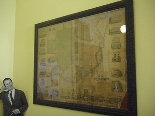 Cardboard Herb Caen poses with the 1853 San Francisco map