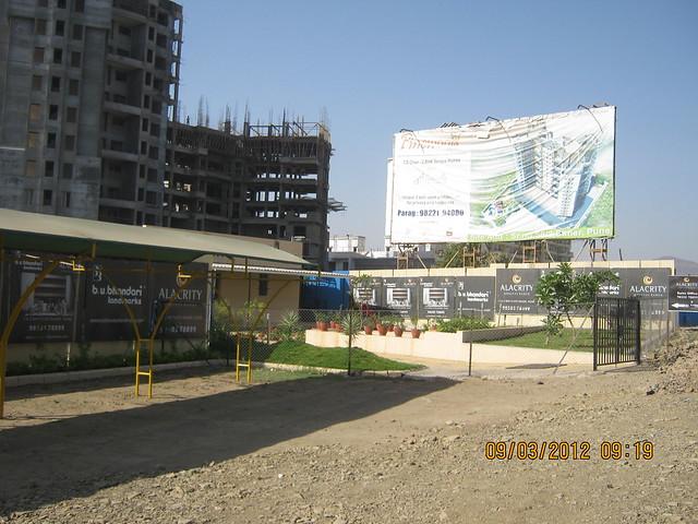Site Office of BU Bhandari Landmark's Alacrity - Hoarding of Prithvi Developers' Pinewood Baner Pune