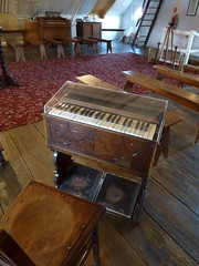 percussion(0.0), electronic device(0.0), piano(0.0), harpsichord(0.0), spinet(0.0), organ(0.0), string instrument(0.0), furniture(1.0), keyboard(1.0), harmonium(1.0),