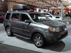 ford escape hybrid(0.0), automobile(1.0), automotive exterior(1.0), sport utility vehicle(1.0), vehicle(1.0), compact sport utility vehicle(1.0), honda pilot(1.0), crossover suv(1.0), honda(1.0), land vehicle(1.0),
