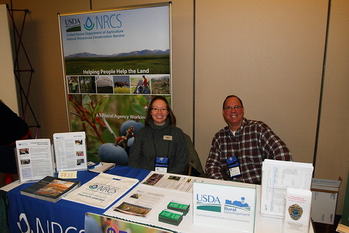 Molly Voeller, Public Affairs Specialist for the Natural Resources Conservation Service in Alaska and Larry Yerich, Public Information Coordinator for USDA Rural Development-Alaska provide agency program and service information to participants and vendors. Photo courtesy of Doug Lindstrand.