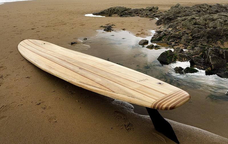 9 foot hollow paulownia wood longboard in Caswell Bay