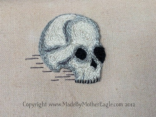 Miniature skull embroidery in split stitch