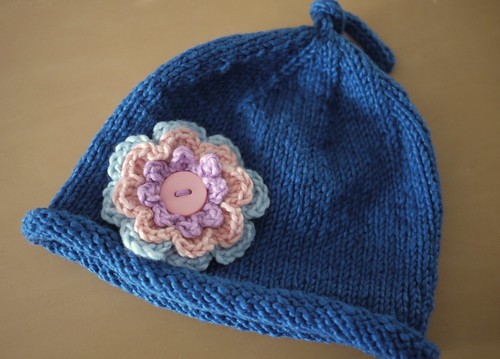 Simple baby hat with flower