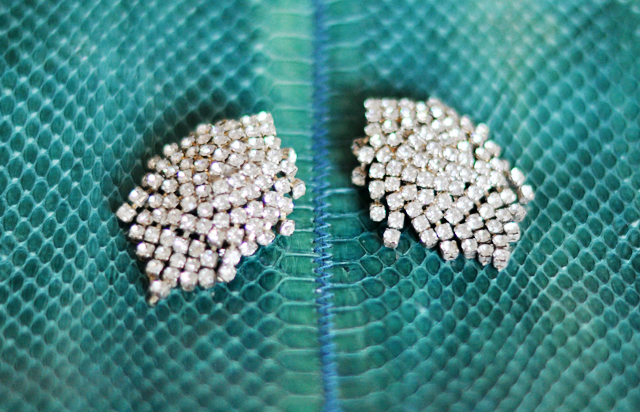 vintage  rhinestone  earrings on   teal snakeskin bag