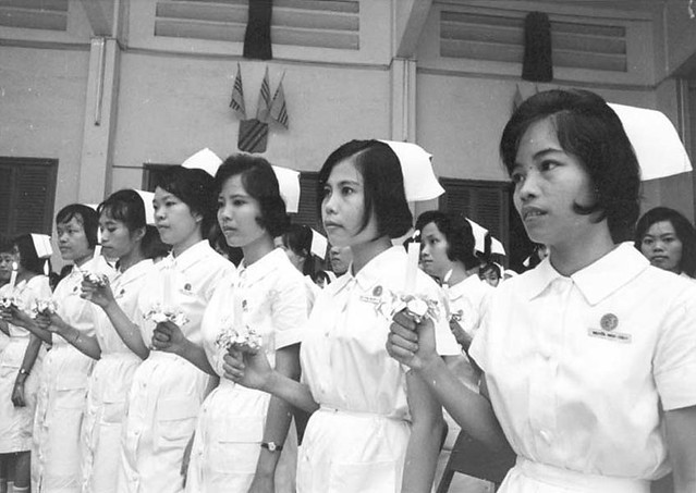 Saigon May 1971 - At the Cho Ray Hospital in Saigon, serious young nurses don their caps and take part in the nursing school's graduating exercises