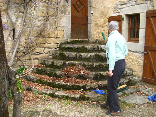 Mum sweeping leaves