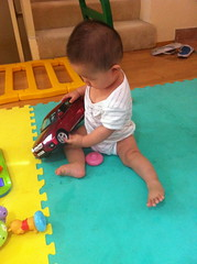 crawling(0.0), child(1.0), floor(1.0), infant(1.0), play(1.0), person(1.0), toddler(1.0), toy(1.0),