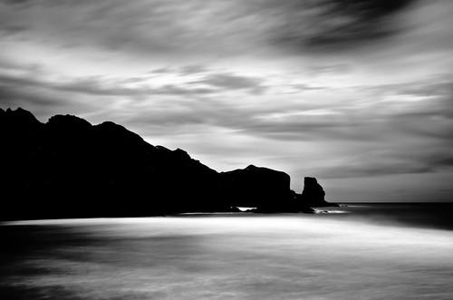 longexposure sea newzealand blackandwhite seascape beach water monochrome clouds coast nikon waterfront auckland filter northisland westcoast bethellsbeach nd110