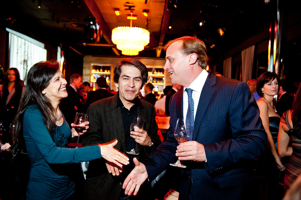 Artists Andrea Arroyo and Felipe Galindo, Jordan's 4 on 4 Art Competition finalists, congratulated by John Jordan of Jordan Winery at the winery's 40th anniversary celebration at the Dream Downtown