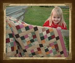Liz behind quilt