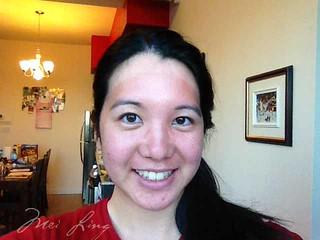 Mei's sunburned face
