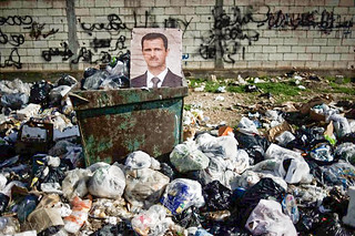 Feb. 10, 2012. A portrait of Syrian President Bashar al-Assad among the trash in al-Qsair