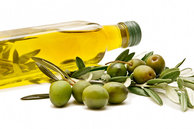 bottle and olives healthy benefits of olive oil