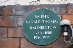 Photo of Ralph Thomas and Gerald Thomas green plaque