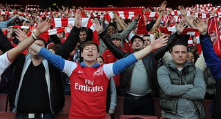 Arsenal fans celebrate, spot the Tottenham supporter