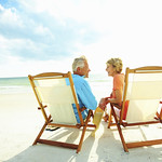 Couple enjoying their golden years on the beach Rimondi Grand Resort and Spa