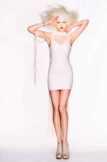 04_White Background Studio Fashion Photography, Ollie Henderson Chic models, white dress salute