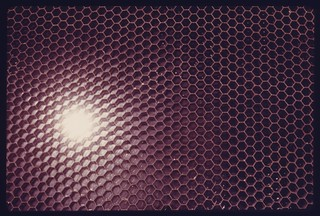 Closeup of an experimental solar heating flat plate collector using bonded honeycomb material for an air heating system, 05/1975.