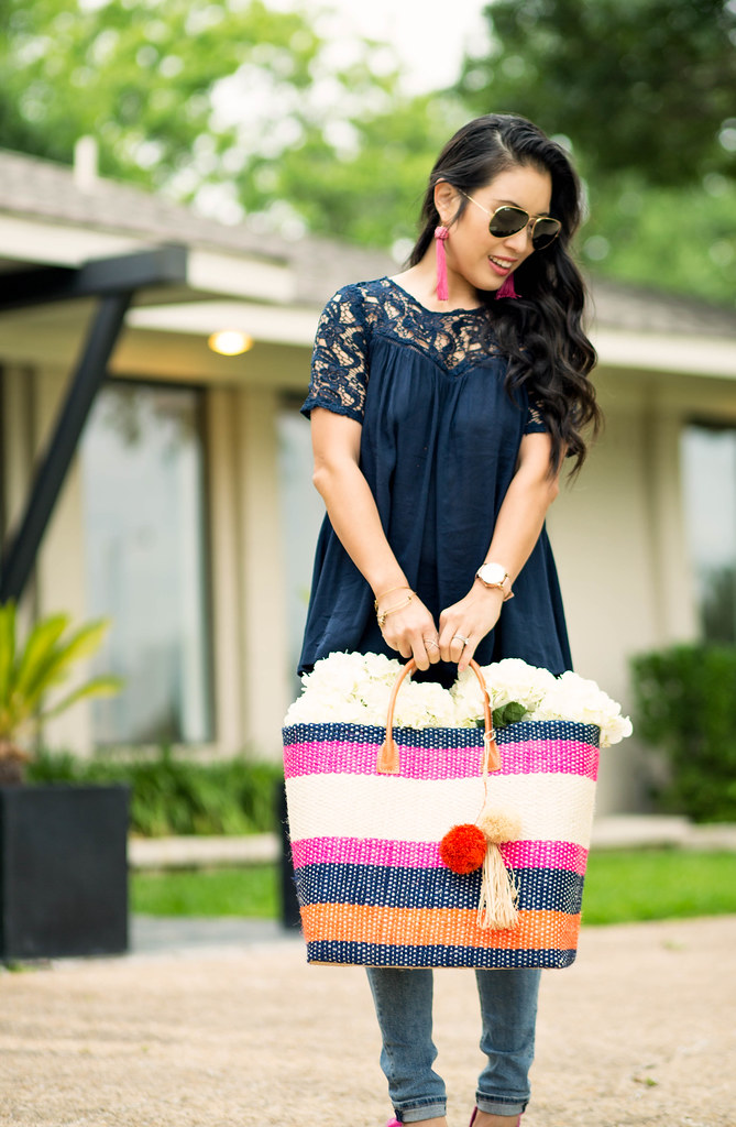 cute & little blog | petite fashion | navy criss-cross lace top, petite distressed jeans, hatattack striped summer straw tote, pink pumps, ray-ban aviators | spring summer outfit
