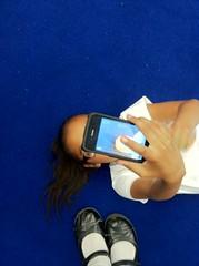 girl on floor taking photo