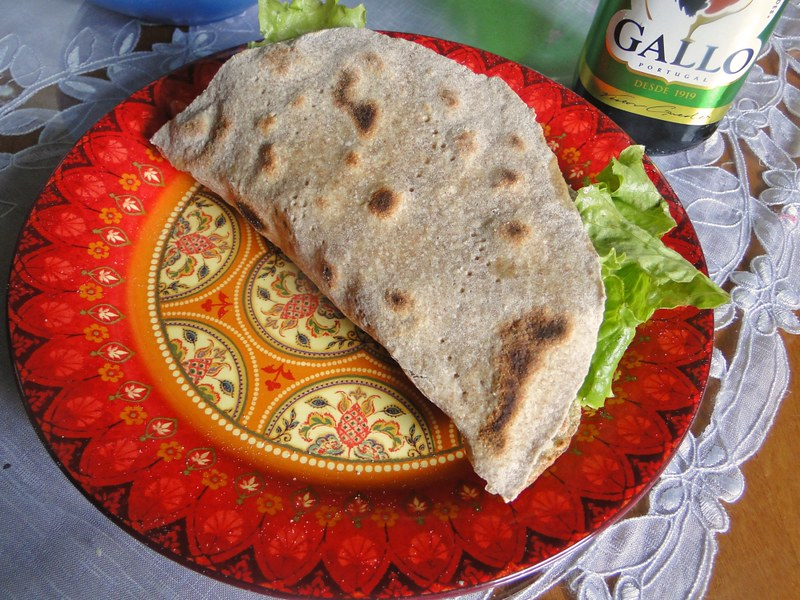 Taco de carne no pão piadina
