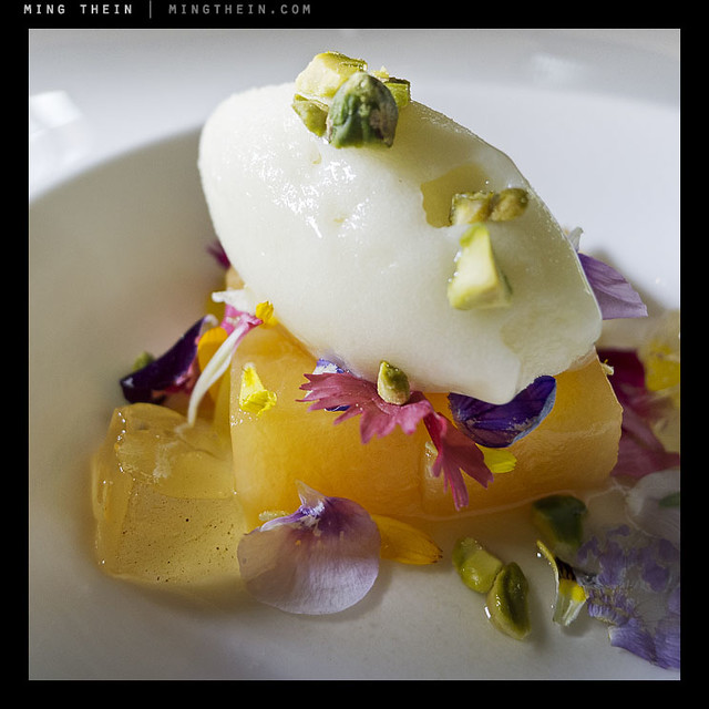 Dessert. Pisco sour sorbet, stewed melon and various flowers.