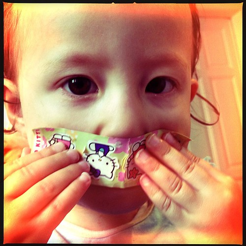 Emily playing with #hellokitty stickers.