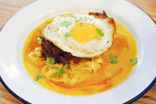 estofado de alpaca alpaca stew estofado, tagliatelle, aji amarillo sauce, fried organic fertile egg