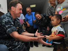 MANADO, Indonesia (June 6, 2012) Capt. James Morgan, mission commander of Pacific Partnership 2012, reaches out to a prospective pediatric surgery patient during a screening program at Siloam Hospital. (U.S. Navy photo by Mass Communication Specialist 3rd Class Laurie Dexter)