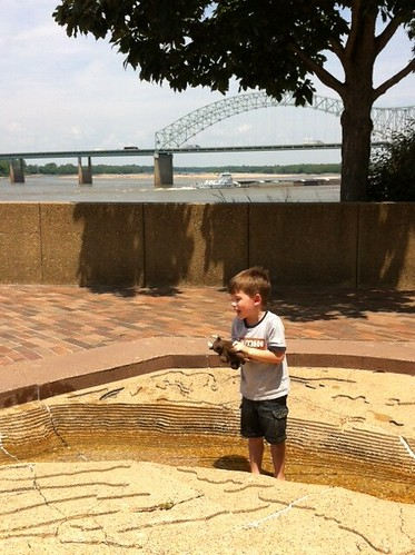Chase and Buddy walking down the Mississippi at the River Walk on Mud Island in Memphis, Tennessee