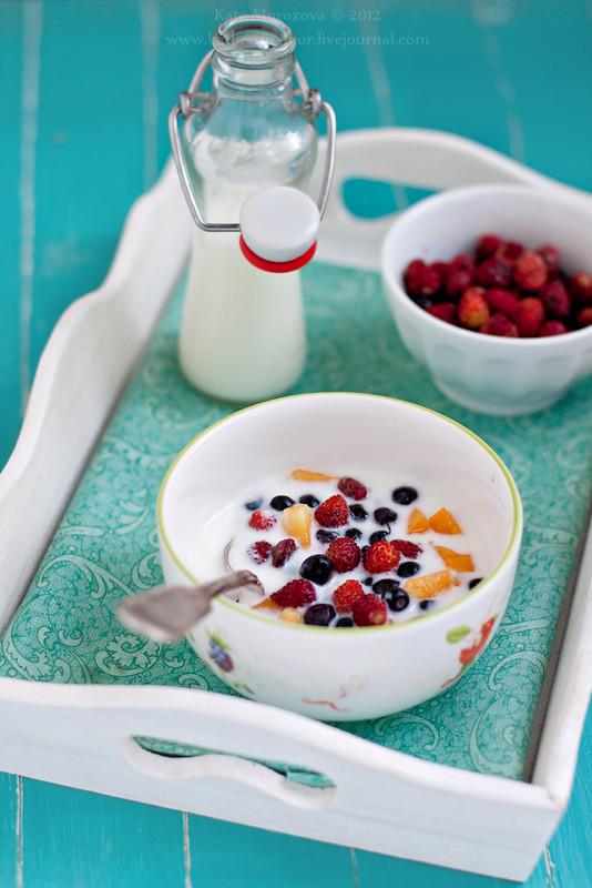 Breakfast. Yogurt, strawberries, blueberries, apricots.