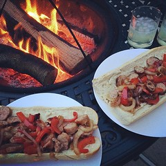 Forget California, this is where I want to be! #Phillies radio, fire, margaritas, & sausage, pepper & onion sandwiches hot off the grill!