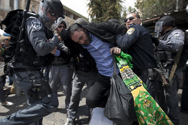 Israeli police officers detain a Palestinian man outside Damascus Gate in Jerusalem's Old City, Friday, March 30. by Pan-African News Wire File Photos