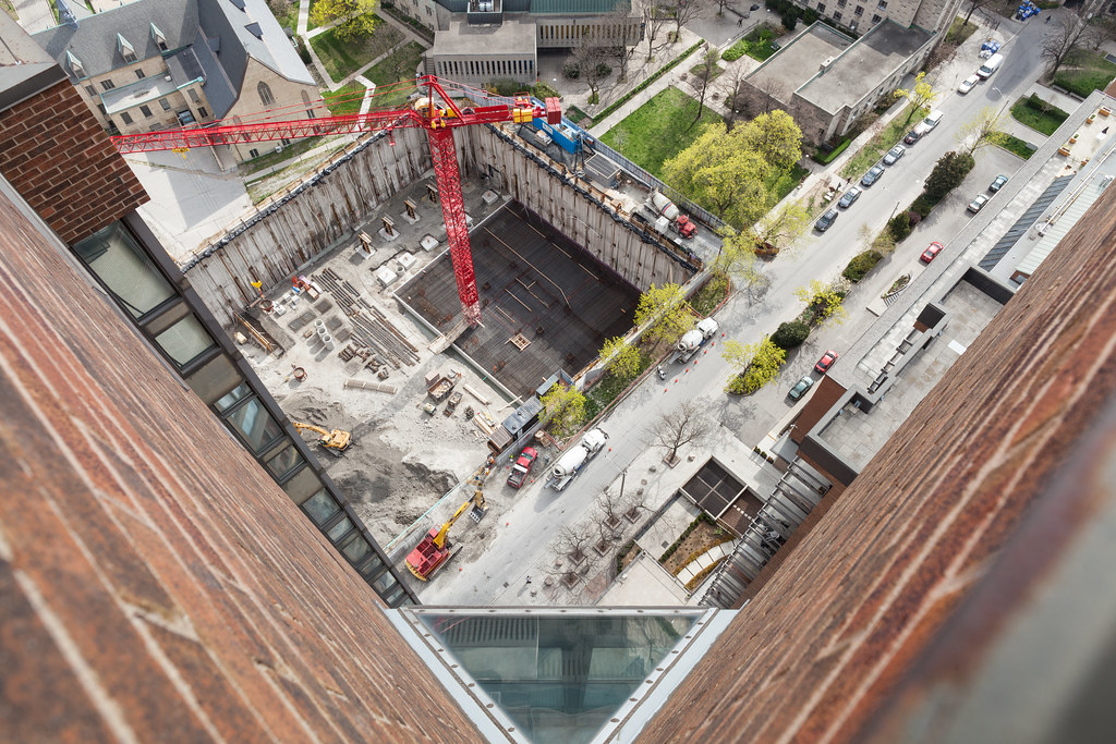 looking down on a toronto construction site from a downtown rooftop