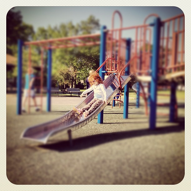 She owned these slides.  (was afraid of them a week ago) #happyincle #park