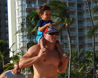 Image of Queen's Surf Beach near Honolulu. kid dad shoulders