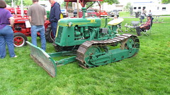 field(0.0), harvester(0.0), machine(1.0), vehicle(1.0), plough(1.0), agricultural machinery(1.0), lawn(1.0), land vehicle(1.0), tractor(1.0),