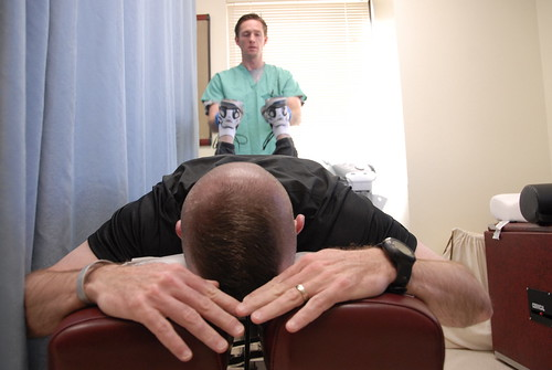 A man getting a chiropractic adjustment.