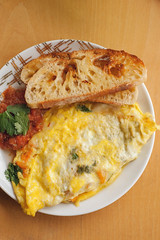 Veggie Omelette with Crispy Toast and Homemade Sal…