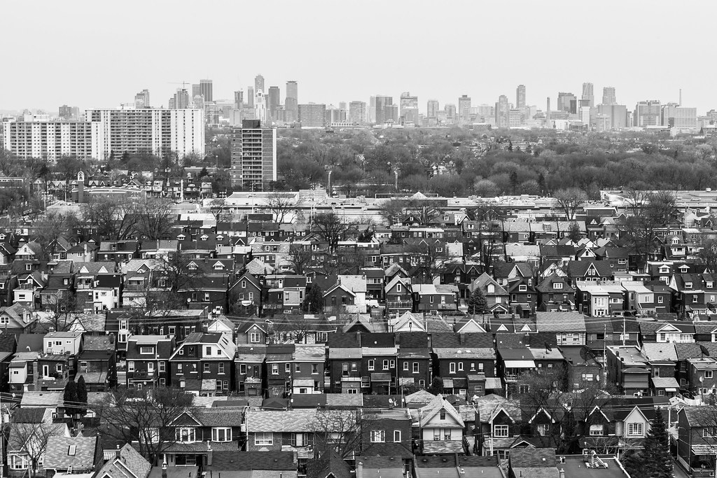 black and white image of toronto skyline looking east from abandoned tower automotive