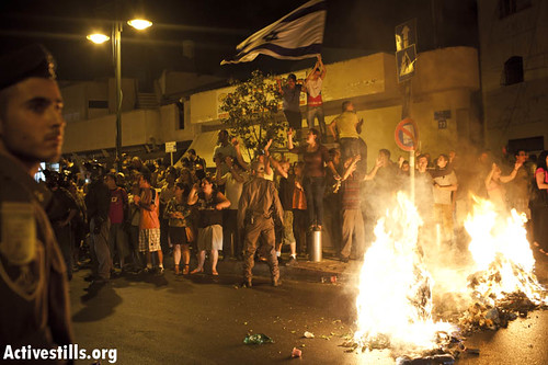 An Israeli mob in Tel Aviv burns garbage and sings, The people want the Africans to be burned.